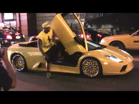 50 cent in times sq in a Lambo
