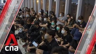 Hong Kong protesters hold sit-in at Yuen Long MTR station