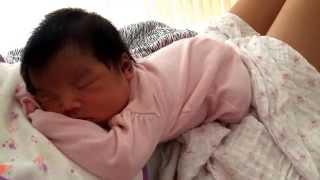 Cuddling my newborn baby girl