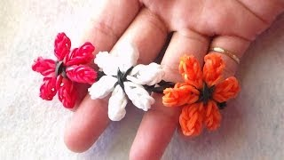 Repeat youtube video PULSERA DE GOMITAS EN FLORES DE LIRIOS SIN TELAR