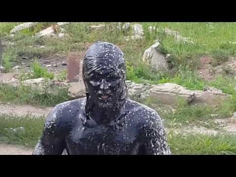 Crazy man  dives into the oil in Russia