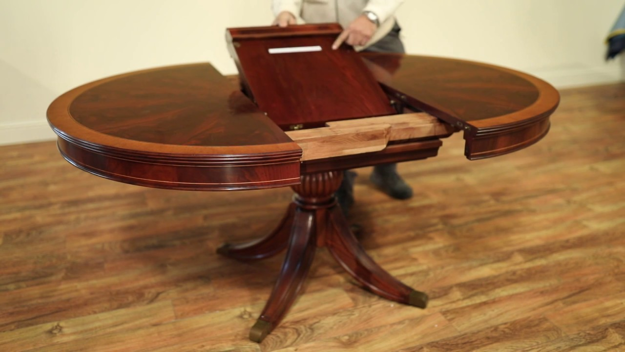 Small Round Mahogany Breakfast Table With Self Storing Leaf DEMO