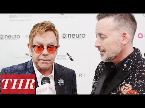Sir Elton John & David Furnish on Why They Throw The Annual Oscar Party | THR