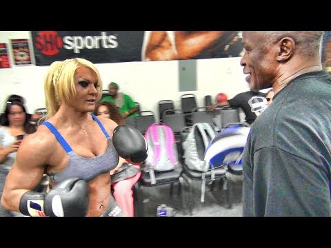 Bodybuilder Lisa Cross gets a boxing lesson from Floyd Mayweather Sr.