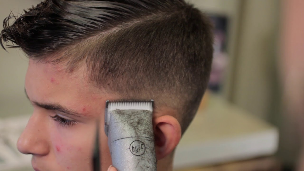 Men's short haircut with clipper over comb