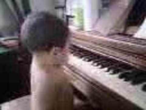 Josiah playing piano