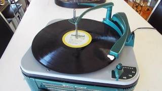 Webcor 3 speed automatic record player / changer playing 33.3 RPM record.
