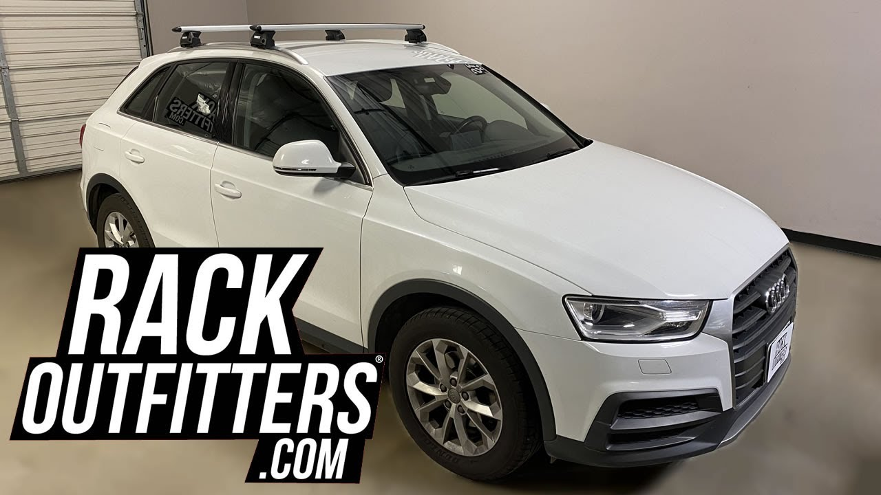 audi q3 outfitted with thule evo flush rail roof rack crossbars