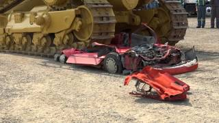 Repeat youtube video Caterpillar D11 versus Pontiac Firefly