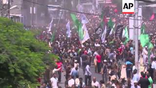 Thousands at funeral procession for Hamas commanders