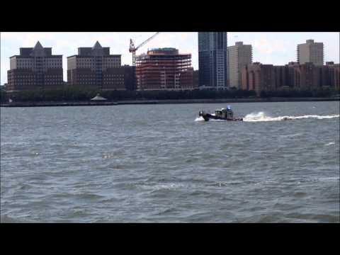 NYPD MARINE UNIT PATROLLING HUDSON RIVER MARINE TRAFFIC IN THE LOWER MANHATTAN ARE OF NEW YORK CITY.