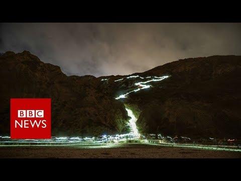 Electric blue waves wash California shore - BBC News