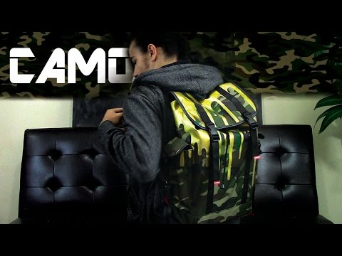 Unbxng - Sprayground Gold Dripping Camo Recon backpack