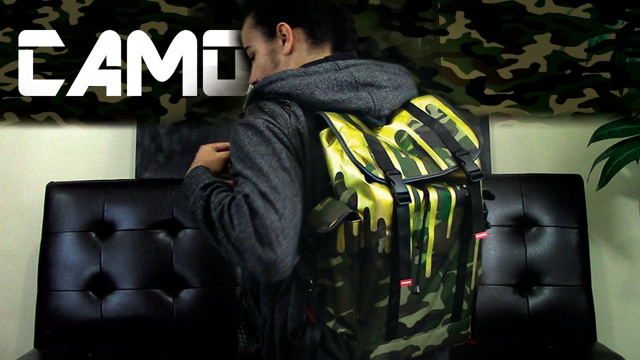 c168cebb92a Unbxng - Sprayground Gold Dripping Camo Recon backpack - YouTube