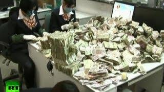Китаец парализовал работу банка, сдав мелочь