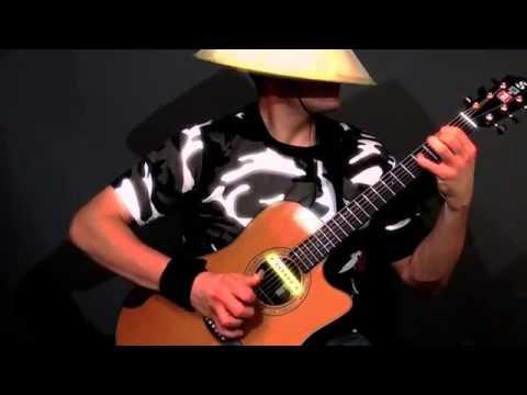 Удивительный стиль игры на гитаре от виртуозного канадского гитариста