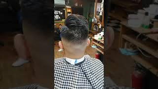 High skin fade pompadour done at Southern Town Social club