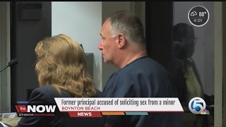 Former principal accused of soliciting sex from a minor
