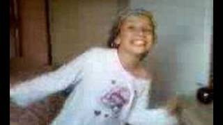 A girl dancing with a shower cap on x
