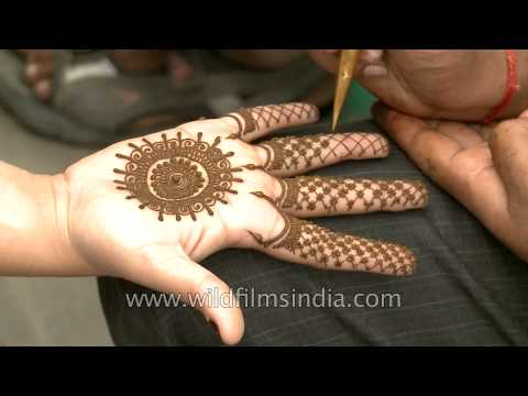 Mehendi being applied in Green Park, New Delhi