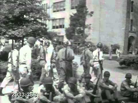 PAN National Guard troops walk in front of Central High School  Little Rock, Arkansas