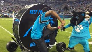 Chicago Cubs pitcher Carl Edwards Jr. beats the Keep Pounding drum at Panthers game