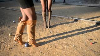 Repeat youtube video 2 sexy girls in Shortest miniskirt playing petanque in 14cm kneehigh boots