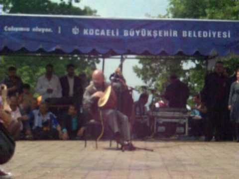 Alevi festival  playing music on traditional instrument