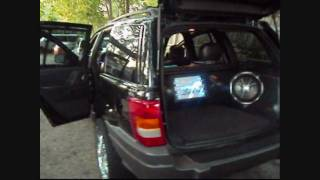 Custom sound system with fiberglass panels on the 2002 Grand Cherokee- Type X Alpine, CVX Kicker