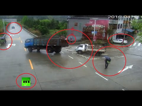 Chinese Crazy Traffic Video: Truck Misses Pedestrian, Smashes Another Truck, Flees