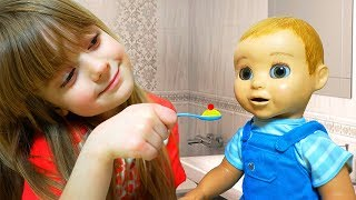 Funny Baby Playing with New Interactive Doll