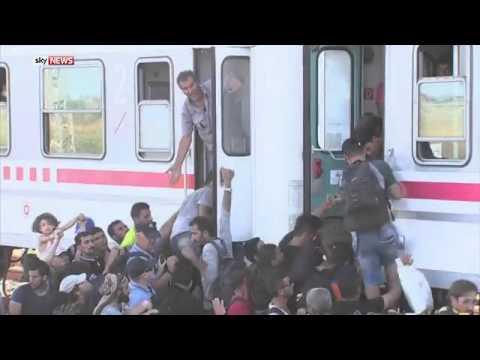 Migrants In Croatian Town Of Ilaca Board Train For Western Europe