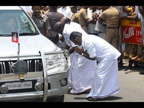 Paneer Selvam saluting Jayalalitha's car tyres-