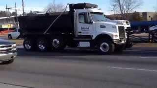 Volvo WG64 vaccum truck and Volvo VHD dump truck