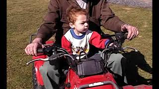Landon & Pop Pop on the four wheeler 2009