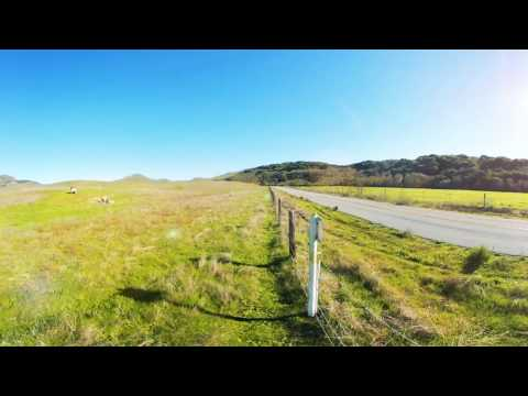 360 Video Of a country road, a spinning windmill and a solitary bicyclist- Turri Rd  SLO