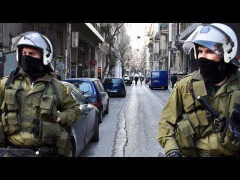 Riot police invades and  attacks three Squats in Athens, Greece