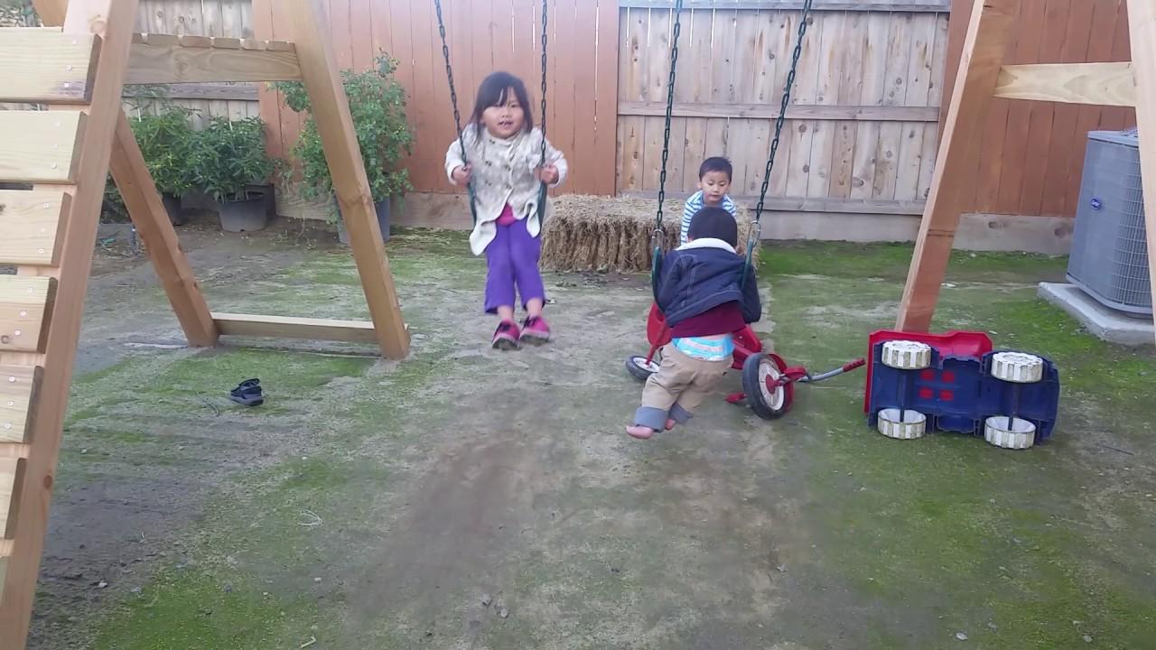 Kids Playing Outdoor Swing N Slide Playsets Hawk S Nest Play Set