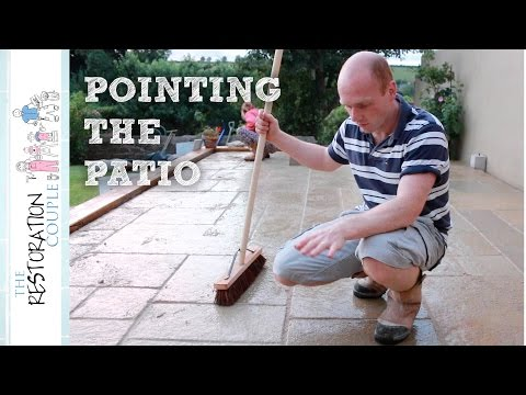 Pointing a Natural Stone Patio using a Brush in Compound