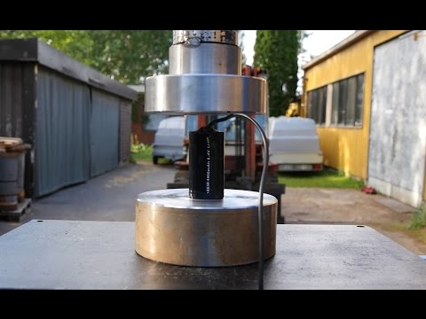 Crushing large lithium batteries with hydraulic press