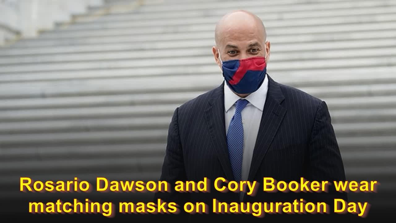 Rosario Dawson and Cory Booker wear matching masks on ...