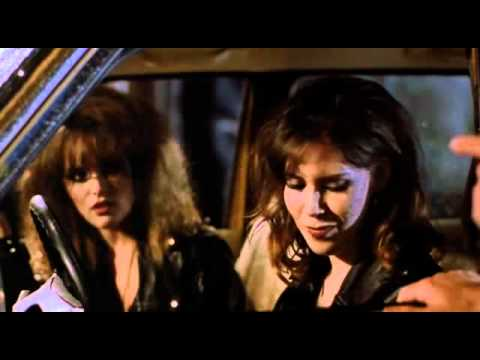 Harvey Keitel gives two girls a warning in