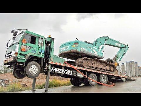 Moving Kobelco SK200 Excavator By Fuso Self Loader Truck