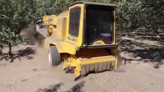 Almond harvesters working to clear the air