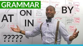 English Grammar -  The Prepositions ON, AT, IN, BY
