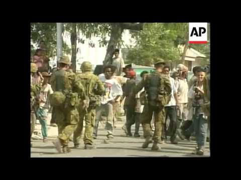 EAST TIMOR: AUSTRALIAN TROOPS ARREST MILITIAMEN (3)