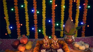 Tilt shot of Ganesh Ji and Lakshmi Ji decorated with Diwali items for Diwali puja