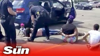 Black family cuffed & held to ground at gunpoint after cops mistake their car as stolen