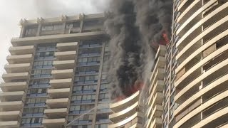 At least three people dead as firefighters battle fire in a Honolulu high-rise apartment building