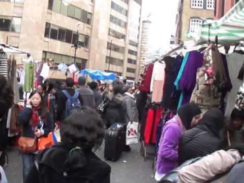 Walking through Petticoat Lane Sunday Market (Gherkin Building in background) - 4th December 2011